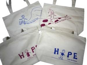 山口さんがデザインしてくれた笑顔袋用トートバッグ